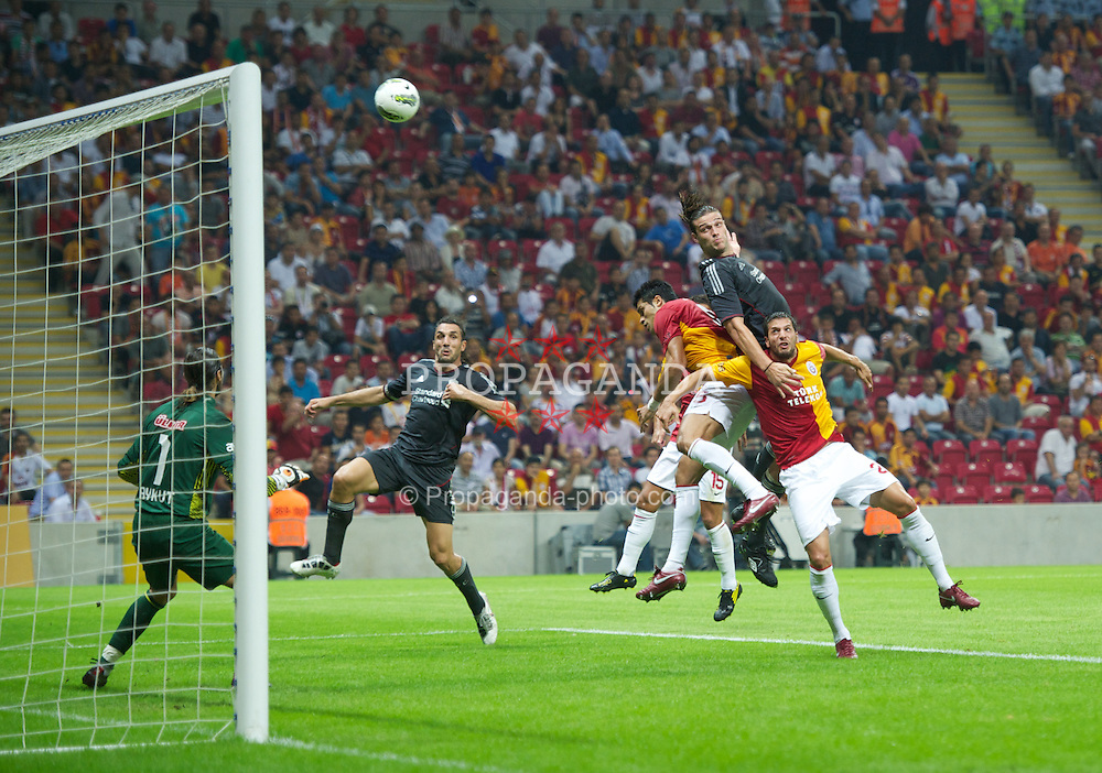 ISTANBUL, TURKEY - Thursday, July 28, 2011: Liverpool's Fernando Torres heads just over the bar against Galatasaray during a preseason friendly match at the Turk Telekom Arena. (Photo by David Rawcliffe/Propaganda)