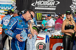 August 12, 2018 - Brooklyn, MI, U.S. - BROOKLYN, MI - AUGUST 12: Monster Energy NASCAR Cup Series driver Kevin Harvick (4) is doused with water by his son in victory lane after  the Monster Energy NASCAR Cup Series Consumers Energy 400 at Michigan International Speedway on August 12, 2018 in Brooklyn, Michigan.(Photo by Adam Lacy/Icon Sportswire) (Credit Image: © Adam Lacy/Icon SMI via ZUMA Press)
