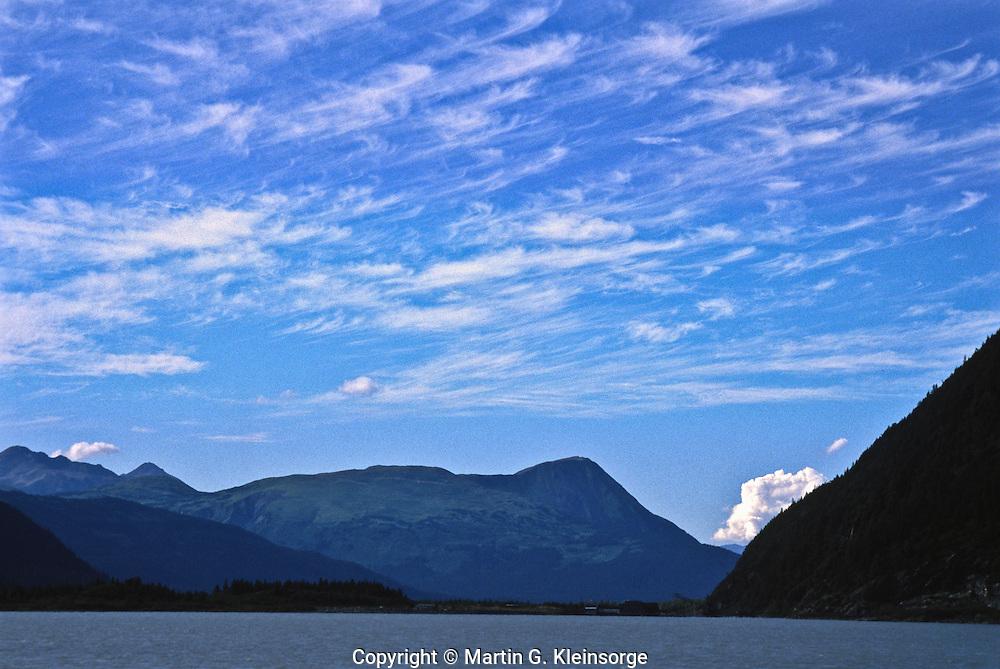 Cirrus uncinus clouds or mare's tails.  Over the Kenai Peninsula, Alaska.