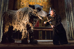 "© Licensed to London News Pictures. 20/03/2014. London, UK. Scene pictured: Father Nandru and grey wolf (with shears). Wilton's Music Hall presents ""Father Nandru and The Wolves"" by Julian Garner, a Romanian fantasy about a Transylvanian village performed with puppets that tell a gypsy tale about wolves and forests. Father Nandru and The Wolves is Wilton's last full scale production before the final stage of repair works begin to the main building at Wilton's, which is the oldest surviving grand music hall in the world.Photo credit : Vickie Flores/LNP"