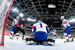 Andrej Hocevar of Slovenia catches a puck during ice-hockey match between Slovenia and Japan at IIHF World Championship DIV. I Group A Slovenia 2012, on April 16, 2012 at SRC Stozice, Ljubljana, Slovenia. (Photo By Matic Klansek Velej / Sportida.com)