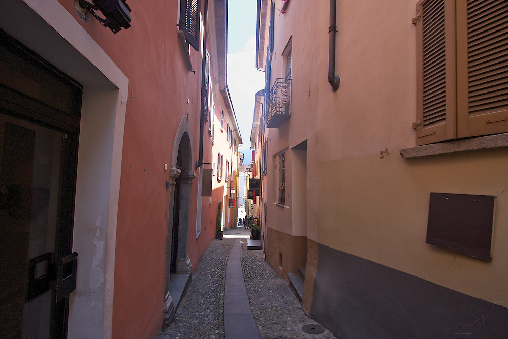 The colorful old world Italian-style back alleys of Locarno, looking down towards the Grand Piazza. Uneven and ascending up steep slopes, they contain pleasant smells from restaurants tucked into corners and the symphonies of daily life...a nice stroll through the old town.