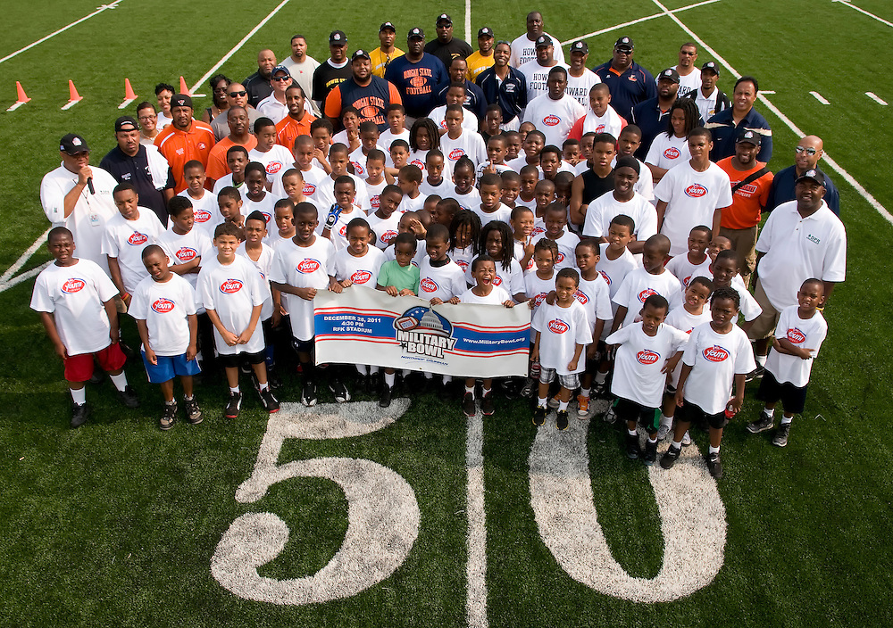 Group photo of coaches and participants that attended the NCAA Youth Football clinic hosted by the Military Bowl presented by Northrop Grumman was held June 11, 2011 at Deanwood Recreation Center in Washington, DC.  ( Alan Lessig/Alan Lessig Photography)........