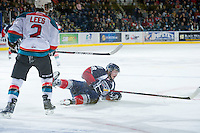 KELOWNA, CANADA - JANUARY 11: Jesse Lees #2 of the Kelowna Rockets checks Ryan Chynoweth #18 of the Tri City Americans at the Kelowna Rockets on January 11, 2013 at Prospera Place in Kelowna, British Columbia, Canada (Photo by Marissa Baecker/Shoot the Breeze) *** Local Caption ***