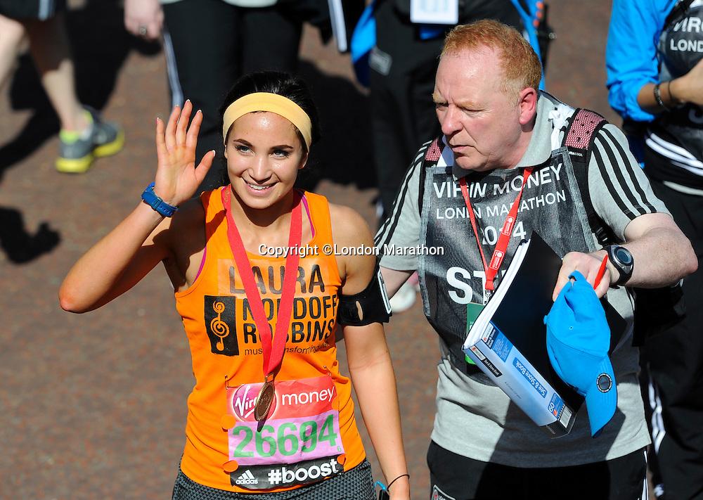Opera singer Laura Wright at the finish<br /> The Virgin Money London Marathon 2014<br /> 13 April 2014<br /> Photo: Javier Garcia/Virgin Money London Marathon<br /> media@london-marathon.co.uk