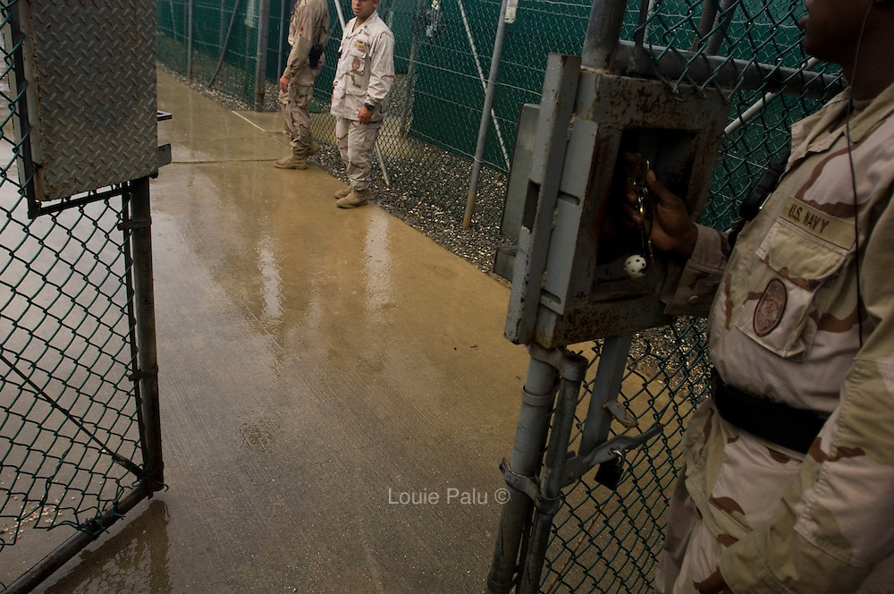 """Oct 02, 2007 - Guantanamo Bay, Cuba - Members of the U.S. military stand by one of several gates one must enter to Camp 1 at the Guantanamo Bay detention facility. The U.S. Government is currently holding approximately 340 """"enemy combatants"""" in Guantanamo Bay, Cuba. They were captured during the """"Global War on Terrorism"""" after the attacks on the United States on September 11, 2001. This photo was reviewed by a U.S. Military official before transmission..(Credit Image: © Louie Palu/ZUMA Press)"""