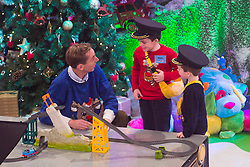 Ryan Tubridy is pictured with toy demonstrators Oisin (8) and Naoise Cooke (5) from Waterford on the Late Late Toy Show 2014. Picture Andres Poveda