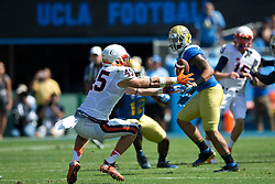 PASADENA, CA - SEPTEMBER 05:  Tight end Evan Butts #45 of the Virginia Cavaliers catches a pass against the UCLA Bruins during the third quarter at the Rose Bowl on September 5, 2015 in Pasadena, California. The UCLA Bruins defeated the Virginia Cavaliers 34-16. (Photo by Jason O. Watson/Getty Images) *** Local Caption *** Evan Butts