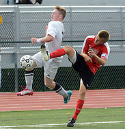 NEWTOWN, PA - SEPTEMBER 08: Council Rock's Dylan Schwartz (L) collides with Hatboro Horsham's Corey Milewski in the second half at Council Rock North high school September 8, 2014 in Newtown, Pennsylvania.  It was the first game since one of their teammates was killed in a car accident Labor Day weekend. (Photo by William Thomas Cain/Cain Images)