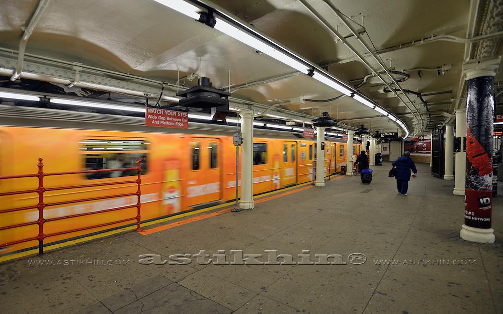 Orange train in motion.