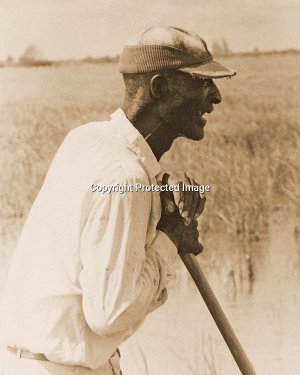"Worker contemplate his long day's work ahead in the rice fields of Colorado County in Coastal Texas. Rendered in sepia tone. NOTE: Click ""Shopping Cart"" icon for available sizes and prices. If a ""Purchase this image"" screen opens, click arrow on it. Doing so does not constitute making a purchase. To purchase, additional steps are required."
