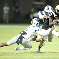 Amory recieiver Kamden Parks drags two Saltillo defenders for the first down late in the second quarter on Thursday