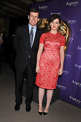 ALEXANDRA ROACH and PADDY BYNG MD of Asprey at the Asprey BAFTA Party held at Asprey, 167 New Bond Street, London on 11th February 2012.