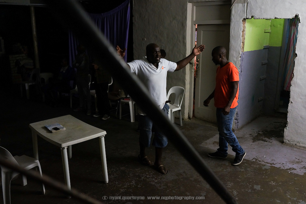 On Wednesday evenings George Khosi, founder of the Hillbrow Boxing Club, runs a prayer meeting in the club's basement. After gunshot injuries from a home invasion put an end to his own boxing career, Khosi started the club to provide discipline, camaraderie and an activity away from the streets for young people from the community, as well as to provide a training ground for upcoming professional boxers. The club operates in the donated space of the forecourt of a disused petrol station in Hillbrow, one of Johannesburg, South Africa's most notorious neighbourhoods.