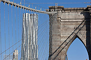 New york  , The Beekman tower new Gehry building under construction in lower Manhattan  area. view from Brooklyn bridge / la nouvelle Tour Beekman de Franck gerry vue depuis le pont de Brooklyn