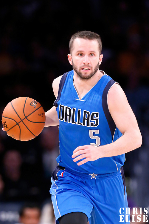 12 April 2014: Dallas Mavericks guard J.J. Barea (5) brings the ball up court during the Dallas Mavericks 120-106 victory over the Los Angeles Lakers, at the Staples Center, Los Angeles, California, USA.