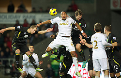 08.12.2012, Liberty Stadion, Swansea, ENG, Premier League, Swansea City vs Norwich City, 16. Runde, im Bild Swansea City's captain Ashley Williams in action against Norwich City's captain Grant Holt during the English Premier League 16th round match between Swansea City AFC and Norwich City FC at the Liberty Stadium, Swansea, Great Britain on 2012/12/08. EXPA Pictures © 2012, PhotoCredit: EXPA/ Propagandaphoto/ David Rawcliffe..***** ATTENTION - OUT OF ENG, GBR, UK *****