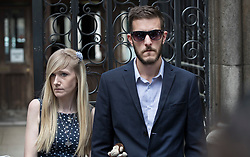 © Licensed to London News Pictures. 10/07/2017. Connie Yates and Chris Gard listen as a family friend reads a statement to waiting reporters outside The High Court. The parents of terminally ill Charlie Gard are returning to court in light of claims of new evidence relating to potential treatment for his condition. An earlier lengthy legal battle ruled that Charlie could not be taken to the US for experimental treatment. London, UK. Photo credit: Peter Macdiarmid/LNP