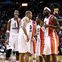 22 January 2012: Miami Heat power forward Chris Bosh (1), Miami Heat small forward Shane Battier (31), Miami Heat shooting guard Mike Miller (13), Miami Heat point guard Mario Chalmers (15) and Miami Heat small forward LeBron James (6) gather during the Milwaukee Bucks 91-82 victory over the Miami Heat at the AmericanAirlines Arena, Miami, Florida, USA.