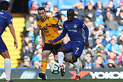 Chelsea Defender Ngolo Kante & Wolverhampton Wanderers forward Diogo Jota (18) during the Premier League match between Chelsea and Wolverhampton Wanderers at Stamford Bridge, London, England on 10 March 2019.