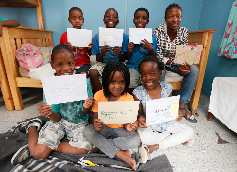 The Kadey kids at home holding the report cards. Alex. Johannesburg   March 2011.Picture by Zute Lightfoot. 0715957313.ww.lightfootphoto.com