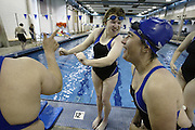 Elise Skovmand, center, dances with Debbie Brassard, right, as the two learn that they will be on the same relay team during practice at the Enumclaw Aquatic Center Saturday, May 19, 2007. The Enumclaw Bluefins are preparing for the Special Olympics Washington Summer Games. ...
