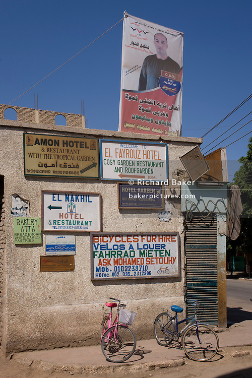 The face of local MP Bairat Mohamed Yasim above rental bikes in the village of Gezirat on the West Bank of Luxor, Nile Valley, Egypt.