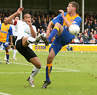 Shrewsbury town v Hereford,Fa cup first round.<br />11-11-2006.Herefords Richard Hope (L) tackels Shrewsbury Michael Symes.