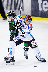 15.12.2013, Hala Tivoli, Ljubljana, SLO, EBEL, HDD Telemach Olimpija Ljubljana vs EHC Black Wings Linz, 54. Runde, im Bild Andrew Jacob Kozek (EHC Liwest Linz, #19) vs Nicholas Ross (HDD Telemach Olimpija, #81) // during the Erste Bank Icehockey League 54th round match between HDD Telemach Olimpija Ljubljana and EHC Black Wings Linz at the Hala Tivoli in Ljubljana, Slovenia on 2013/12/15. EXPA Pictures © 2013, PhotoCredit: EXPA/ Sportida/ Matic Klansek Velej<br /> <br /> *****ATTENTION - OUT of SLO, FRA*****
