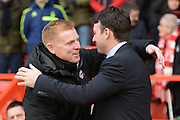 Nottingham Forest manager Dougie Freedman and Bolton Wanderers Manager Neil Lennon cuddle during the Sky Bet Championship match between Nottingham Forest and Bolton Wanderers at the City Ground, Nottingham, England on 16 January 2016. Photo by Alan Franklin.