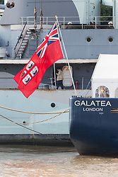 © Licensed to London News Pictures. 12/09/2017. LONDON, UK.  A man walks past the London International Shipping Week flag on THV Galatea which has arrived in London and is moored next to HMS Belfast for London International Shipping Week. THV Galatea is a Trinity House multi-function ship, designed to carry out marine operations as part of their duty as the General Lighthouse Authority for England, Wales, the Channel Islands and Gibraltar. An estimated 15,000 shipping industry leaders are expected to attend events in London and on board the THV Galatea during International Shipping Week this week. Photo credit: Vickie Flores/LNP