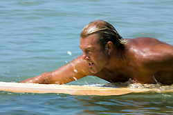 Man paddling on surfboard