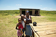 African family near the Hluhluwe Umfolozi game reserve.  Northern KwaZulu Natal, South Africa