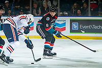 KELOWNA, CANADA - SEPTEMBER 22: Jermaine Loewen #32 of the Kamloops Blazers skates with the puck by Kaedan Korczak #6 of the Kelowna Rockets on September 22, 2018 at Prospera Place in Kelowna, British Columbia, Canada.  (Photo by Marissa Baecker/Shoot the Breeze)  *** Local Caption ***
