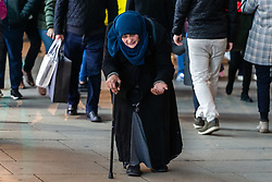 """A stooped old woman with a walking stick wanders along Oxford Street, her free hand outstretched, repeating """"Help me my darling"""" to shoppers. Homeless Britons are coming under increasing pressure as a surge of Roma beggars from Romania arrive on the streets of London to take advantage of the generosity of Christmas shoppers. London, December 04 2018."""
