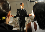 Designer Zac Posen speaks to models before his Spring 2015 collection is shown during Fashion Week in New York, Monday, Sept. 8, 2014.  (AP Photo/Diane Bondareff)