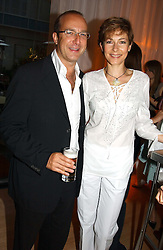 PAUL MCKENNA and DEBORAH MOORE at a party at The Sanderson Hotel, Bernnnnners Street, London in aid of Sargent Cancer Care for Children on 7th July 2004.