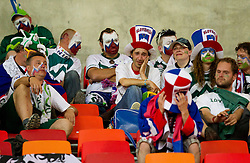 Dissapointed fans of Slovenia cry after the 2010 FIFA World Cup South Africa Group C Third Round match between Slovenia and England on June 23, 2010 at Nelson Mandela Bay Stadium, Port Elizabeth, South Africa.  (Photo by Vid Ponikvar / Sportida)