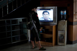 A KIA's soldier watch a television serial during his guard at War Office in Laiza village close to the China border, Myanmar on July 14, 2012. The KIA formed in 1961 in response to a military coup in Burma led by General Ne Win, who attempted to consolidate Burmese control over regions on the periphery of the state which were home to various ethnic groups. From 1961 until 1994, the KIA fought a grueling and inconclusive war against the Burmese junta. In 2011, general Sumlut Gun Maw confirmed renewed fighting in the state of Kachin for independence. One of the new reasons for the ending of the ceasefire is the creation of the Myitsone Dam which requires the submergence of dozens of villages in Kachin state.