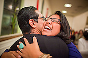 19 DECEMBER 2010 - PHOENIX, AZ:  DULCE JUAREZ hugs DANIEL RODRIGUEZ, a prayer service for the DREAM Act in Phoenix. Rodriguez participated in a hunger strike at the offices of US Sen. John McCain in support of the Act. McCain, who several years ago supported the DREAM Act, voted against it Saturday. About 100 supporters of the DREAM Act gathered at First Congregational Church of Christ in Phoenix Sunday night, December 19, for a prayer vigil in support of the DREAM Act, which was defeated in the US Senate Saturday, Dec. 18. The DREAM Act, was supported by the Obama administration, and was an important part of the administration's immigration reform platform. The defeat of the DREAM Act, which would have established a path to citizenship for undocumented immigrants who were brought to the US by their parents when they were children, set back the President's immigration reform efforts.    PHOTO BY JACK KURTZ
