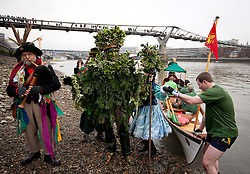 © Licensed to London News Pictures. 06/01/2013. London, UK. A member of the 'Bankside Mummers' dressed as the 'Holly Man' steps ashore after being rowed along the Thames during the annual 'Twelfth Night' Celebration in London today (06/01/13). The tradition, a pagan celebration of the new year and the end if Christmas, takes place every year at Bankside outside the Globe Theatre and sees the actors of the Bankside Mummers perform for the public. Photo credit: Matt Cetti-Roberts/LNP