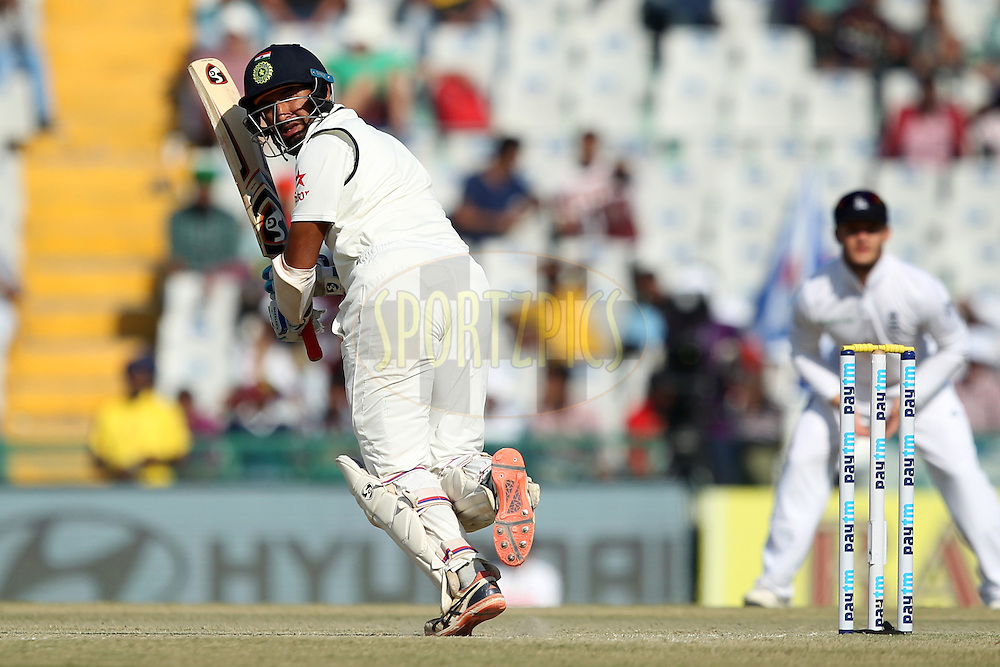 Cheteshwar Pujara of India in action during day 2 of the third test match between India and England held at the Punjab Cricket Association IS Bindra Stadium, Mohali on the 27th November 2016.Photo by: Prashant Bhoot/ BCCI/ SPORTZPICS