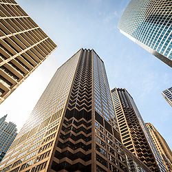 Chicago architecture city skyscrapers upward view looking up toward a blue sky