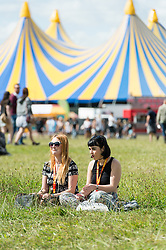© Licensed to London News Pictures. 22/08/2014. Reading, UK.   Festival goers at Reading Festival 2014 on Friday morning, the opening day, shortly after the gates open at 11am.  The weather is sunny with light cloud.   Today is expected to remain dry with a 25% risk of showers.  Photo credit : Richard Isaac/LNP