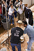 A Jaycee volunteer snake handler skins western diamondback rattlesnakes during the 51st Annual Sweetwater Texas Rattlesnake Round-Up March 13, 2009 in Sweetwater, Texas. During the three-day event approximately 240,000 pounds of rattlesnake will be collected, milked and served to support charity.