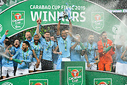 Vincent Kompany (4) of Manchester City lifts the Carabao Cup as champaigne is sparyed during the trophy presentations celebrations during the Carabao Cup Final match between Chelsea and Manchester City at Wembley Stadium, London, England on 24 February 2019.