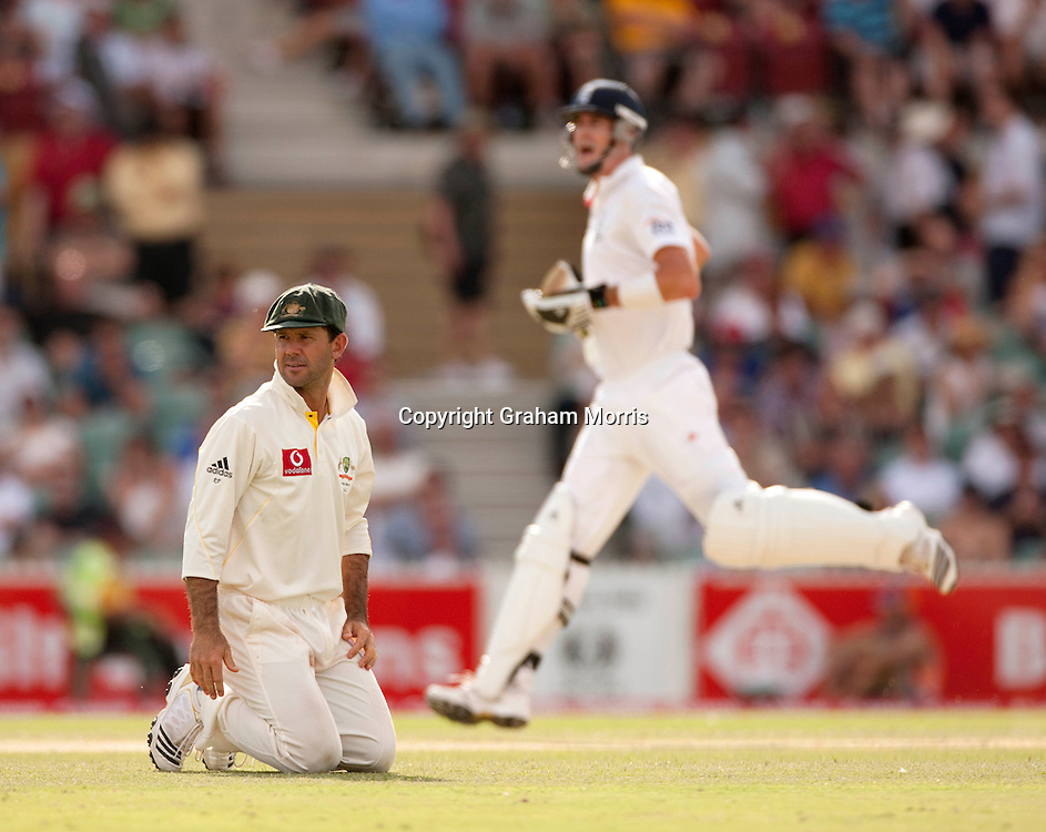 Captain Ricky Ponting is brought to his knees by Kevin Pietersen (right) during the second Ashes Test Match between Australia and England at the Adelaide Oval. Photo: Graham Morris (Tel: +44(0)20 8969 4192 Email: sales@cricketpix.com) 4/12/10