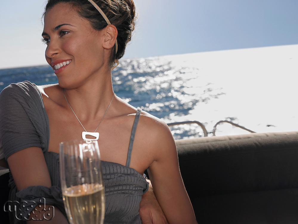 Woman Drinking Champagne on Boat