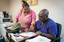 Shannon Brewer, left, manager of the Jackson Women's Health Organization, speaks with Dr. Willie Parker, on Monday August 18, 2014, in Jackson, Mississippi. This is the only clinic in the entire state that performs abortions. (Photo © Jock Fistick)