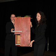 Evin Grody and Amy Daum hold up an auction item at the 2007 USEA Convention and awards dinner in Colorado Springs, CO, USA
